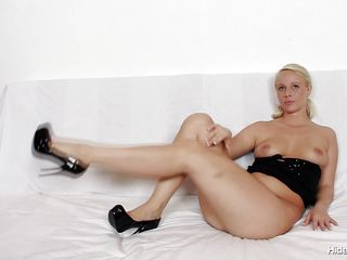 This young slut with perfect body is sitting naked on her white sofa. Her name is Ingrid and she is hiding something black in her tight and sexy vagina. She takes out from her pussy a pair of black transparent pantyhose and dress with it. Now she begins rubbing her clitoris because she want to have an orgasm.
