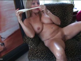 Luna is a brunette mature with natural big tits who likes using dildo on her shaved vagina. Her husband is out of town so she sits naked on the chair, enjoys orgasm and masturbate. She is waiting for a nice big dick that can fuck her cunt hard.