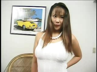 Busty Asian chick Chinatsu Matsuda bares her tits and gets a cock rubbed on them