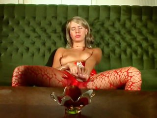 She removes pantyhose and plays dirty