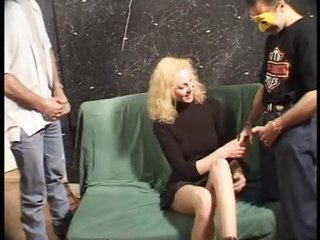 Gangbang for a cute blonde in a dress