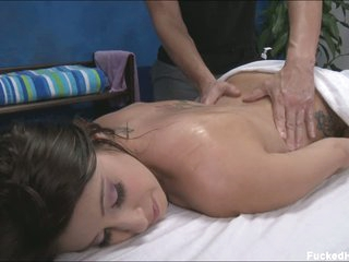 Brunette Abby gets nude for body massage