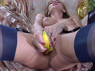 Tipsy hottie in vintage red pants and black nylons freaks out with a banana