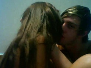 This hot teen couple has a kink for letting strangers watch them on the webcam while fucking. The stunning girl jerks and sucks her boyfriend's hard dick. Then, the boy plunders her pussy from behind.