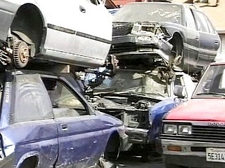 Short-haired MILF hottie gets herself fucked by two guys in a junkyard