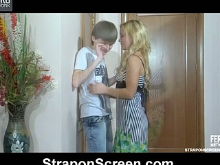 Heated blondie shoves her strap-on knob betwixt a skinny chap