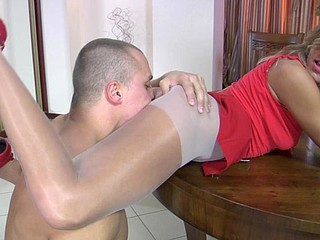 Lady in red widen on the table and nailed down in her ultra shiny tights
