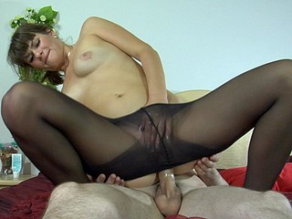 Mischievous honey in black hose playing numbers game and riding a subrigid dick
