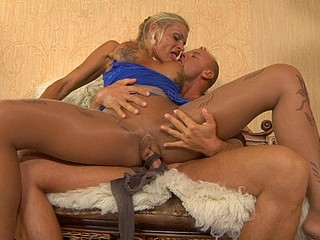 Golden-Haired rubs a ramrod with her hands clad in hose expecting for raw dicking