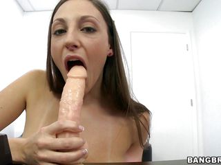Here is a new dark haired bitch Melanie Hicks with her tight sexy body stripping fo a photo shoot. One by one she shows her tits, ass and finally the pussy. The photographer put a dick like dildo in the table which she starts sucking. Getting horny, she masturbates and fucks herself with that toy!