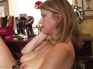 Daphne, a hot 44 years old milf is talking on the phone and she decides to masturbate. She can't wait any longer and talking to the phone is just making her more horny so she starts fingering her pussy. Even she is a mature women she enjoys playing with herself. Do you think she will reach orgasm?