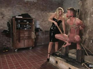 She got her man tied pretty nice and now she's having some fun with his body, paying a lot of special attention to his cock. This hot bossy milf with blonde hair and fit body is using her tools to taunt and induce pain to her man. Look at her spanking his cock and body as he's tied up and ball gagged.