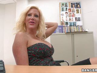 Busty boobs milf Dawson is always ready to enjoy some action. Here this blonde milf is quickly stripping in the office and showing her nice, sexy and attractive boobs with hard nipples. Seeing those nice tits when his man's dick has gone completely hard he wants her to suck his man mean right there.