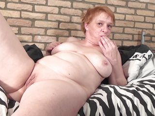 Angel Fire is a sexy milf. This bitch has got busty boobs and nice body. He re she is getting out of control and crushing her boobs like hell. Then she is rubbing her pussy with a big dildo and right after that she is inserting it in her wet pussy. After that she is licking her own juice from that dildo to take the happy feeling.