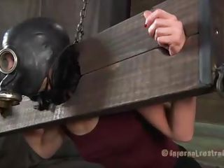 It's a pleasure to see her crying. Elise was a very bad slut girl and she is being punished for her sins. A gas masked is putted on her head making breathing a very hard thing to do and then these two executors spank her body with sticks. She suffers and barely stands on her feet, luckily she's tied with a chain