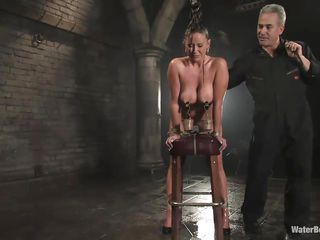 Christina Carter is a well known pornstar. The brown haired diva has a gorgeous body with huge tits and a sweet round ass. Being tied up on that table, she stands powerless, as that old guy comes and attaches things to her pussy. While being machine fucked, a hose is spreading water all over her pussy.