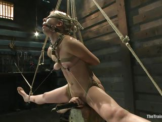 Chastity Lynn is a blonde milf who enjoys being tied up with ropes. She likes when she is not able to move her hands and feet freely. As she stands helpless with a ball gag in her mouth and a rope blindfold on her eyes, a friend is giving her a big time pleasure, rubbing her cunt with a vibrator.
