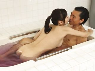 Japanese beauty Kimika is a milky white milf with sweet breasts, dark hair and a huge desire to satisfy her man in each possible way. She is in the bathtub with him and sucks his dick gently before offering a titjob. He repays his lady with some pussy licking and then get out of the tub for some oily massage