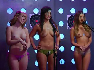 The Playboy Morning Show is radio but with cameras so you can watch as well as listen. Today, the Playmate guest is instructing a blonde hottie and two sexy brunettes on topless pushups. They better follow orders or this big-breasted black lesbian is going to spank their asses! Luckily they do well.