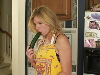 Our blonde mommy knows that's not nice to play with the food but she can't help herself not to do it. After she sucked that cucumber nice and slow she sticks it in her tight pussy and then grabs a carrot. Well, she's trying to make a salad or fuck herself, perhaps both? Let's find out!