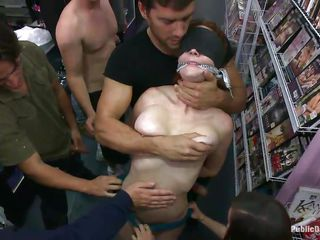A beautiful red head milf who is ball gagged and tied up gets publicly disgraced by a group of men. They humiliate her by fingering her tight pussy, giving her a blowjob, fucking her cunt and then banging her ass from behind with their big dicks.