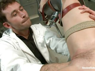 It's a hard exam for Ash's pussy, she's tied with red leather belts on the gynecologist table and her doc performs a hard fisting before taking out his cock and fuck her deep. She moans with pleasure as his hand goes deep in her womb and then his penis, wonder if he will cum in her delicious vagina?