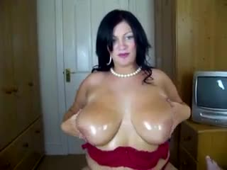Hot BBW strips erotically and gives a titjob