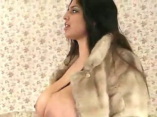 Fat chick in fur coat gets naked