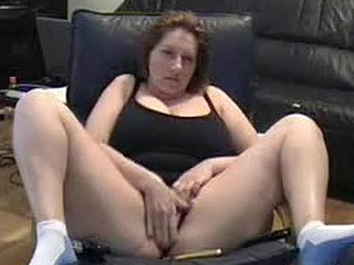 Sexy Milf lets her dusty camera know that she hasn't lost her edge. She cleans off the dusty camera in this amateur webcam video and spreads her legs wide for the camera while she masturbates her big wet pussy.