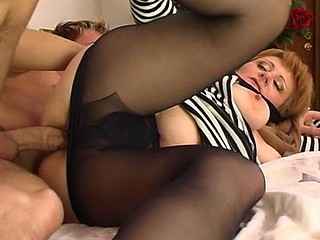 Sultry aged sweetheart in sheer-to-waist hose putting her gazoo in the air