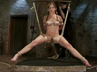 Felony is a sexy milf and she's about to get a ruff treatment just the way we like to watch. Her executioner ties those sexy legs real hard and hangs her with her legs spread as wide as possible, she hangs there in balance and gets a vibrator on her unshaved pussy.