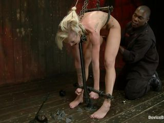 Does she likes being tied up real hard and humiliated? I think she does and her shaved sweet cunt asks for cock as she gets more and more excited. Her punishment is only going to get harsher as the black guy finger and slaps her butt from behind. In the next scene is is laid on her belly and her tied with leather strains. Does the black guy has something special for her pussy?