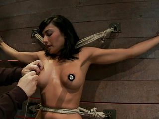 Her hard nipples are tied with rope and her executor adds a lot of laundry pliers on her tits, her sexy boobs are punished hard and her cunt is vibrated, giving her a hot punishment. She enjoys the pain induced on her boobs and I bet there's a lot more for her soon.