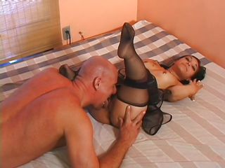 This short slut is in her bed when a horny guy appears and takes off his pants showing his big and thick penis. The little bitch is crazy for dicks so she starts sucking guy cock with her small mouth. The guy return the service and he is licking her very tight vagina before penetrate her very deep.