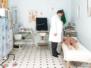 Naked Mature lady with big tits visits the doctor for her pussy examination. She is ordered to lay on the patient's bed doctor examines her abdomen and then wears his gloves and tells her to spread her legs so that her cunt can be tested. Doctor examines it and then checks her ass and ask her if she had anal sex ever she replied with no.