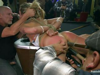 Blonde diva is tied up with ropes. She loves being being mouth fucked and having big objects deep in all her holes. Watch this horny milf moaning with both pleasure and pain while Mark Davis is fucking her throat roughly and his friends are pushing objects into her vagina and asshole.