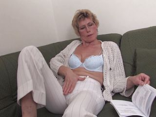 This granny is in her living room on the sofa and she is reading a book. While she reading she begins to touch her nice body and slowly she takes off her blouse and bra showing a pair of perfect round boobs good for licking. She goes down now in her pants and starts masturbating very slow.