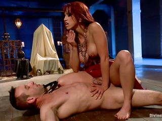 Nicki Hunter is a hot red haired milf craving for cock with huge tits and a sweet round ass. She has the perfect slave, young Jason Miller tied up on that wooden board with ropes. Being aroused by his pleasure and pain after she sits on his face, she has a squirting orgasm.