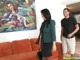Gorgeous brunette milf Scarlett Daze becomes friend with a goodlooking white guy. After giving him her number, he calls the sexy diva and waits for her to get there. She knows what that man wants and starts flashing her tits around in a transparent blouse. The sex goddess takes his cock and sucks on it hard.