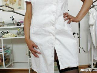 This mature nurse dressed in a white medical suit start to strip while she is at her workplace. She have big and round tits and she start playing with her nipples. The mature bitch take off her black panties to show her big sexy ass and her deep and large vagina.
