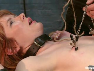 Claire just sits there waiting for the executor to do his job He uses clamps for her nipples and an empty bucket to pull them. Heavy lockers are used to make the bucket heavy and soon her nipples are pulled hard. He then gives her some tips after she said please. Look at that wet pussy, she's great!