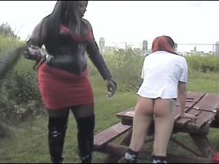 Ebony mistress punishes her slave's white ass